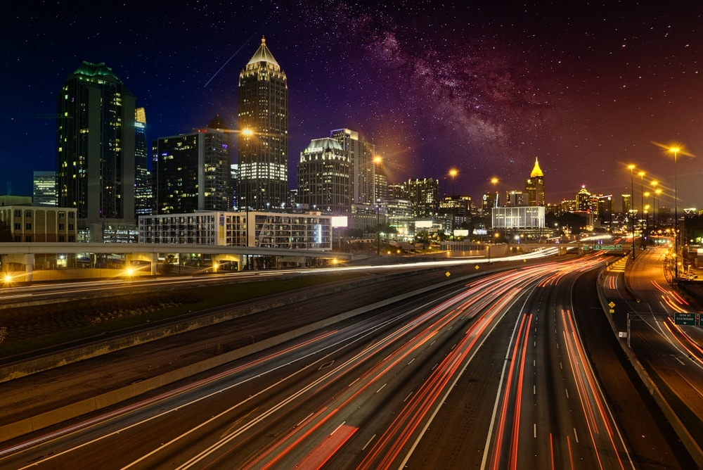 The City of Atlanta at night with a starry-sky background