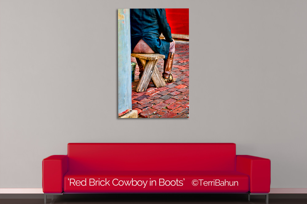 RED brick cowboy in boots, by terri bahun
