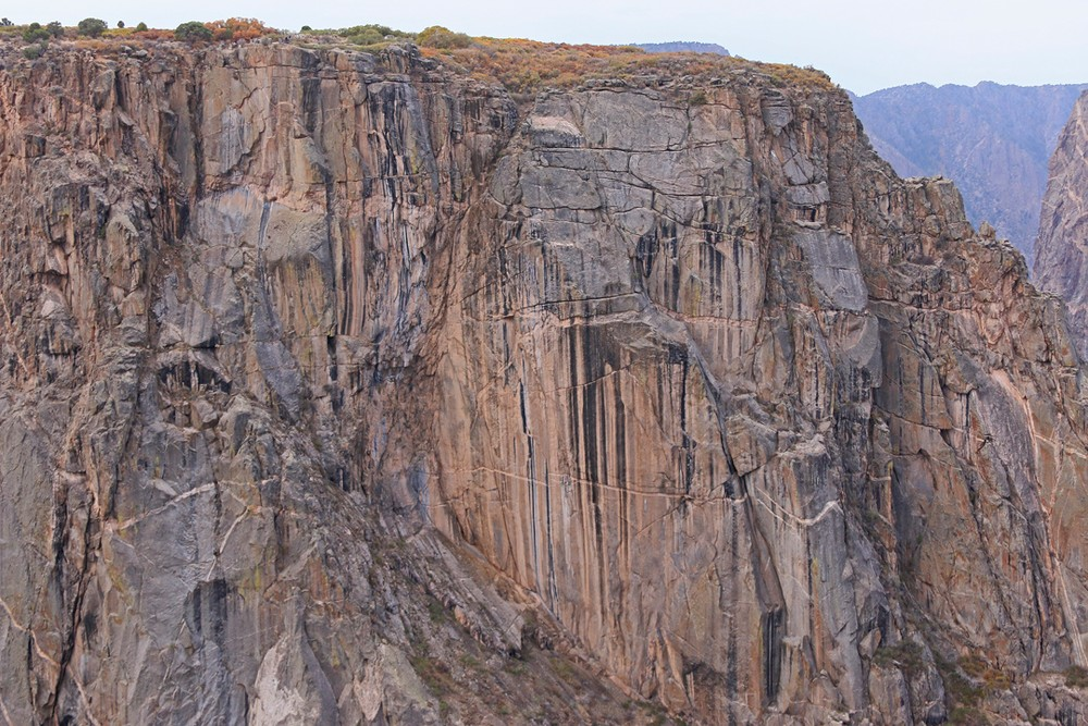 Bacterial oxidation forming black vertical stripes on Canyon wall.