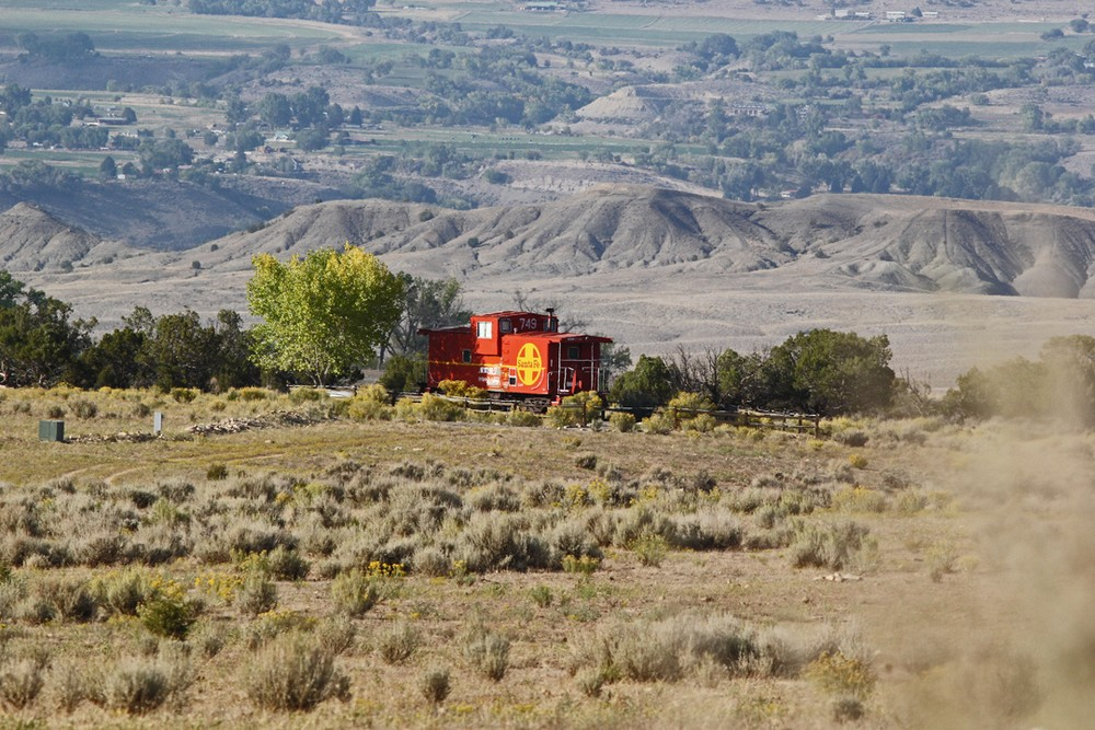 Caboose on a hill.