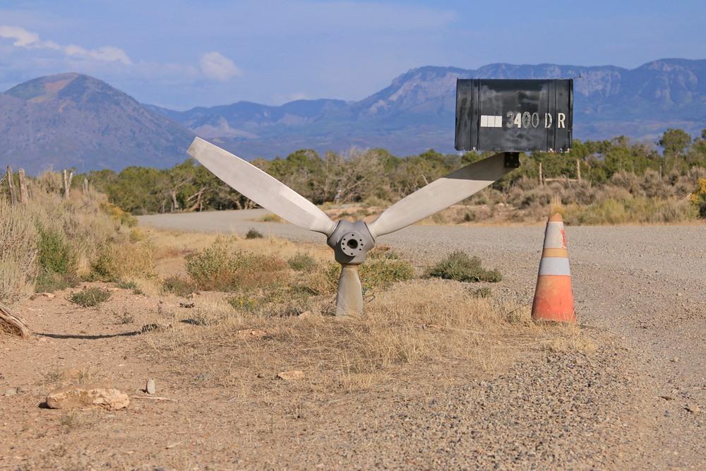 Airplane propeller mailbox support.