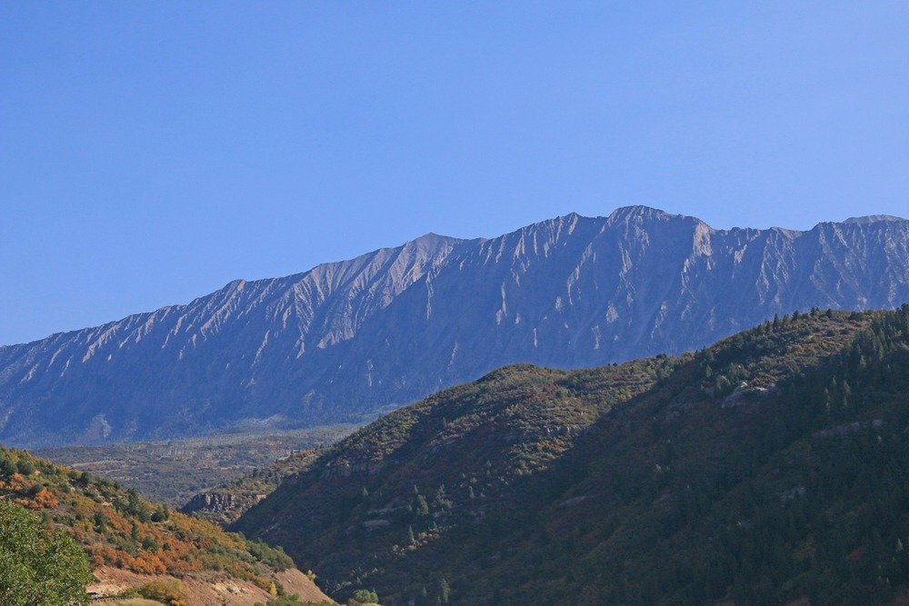 Craggy mountain ridge with deep shadows.