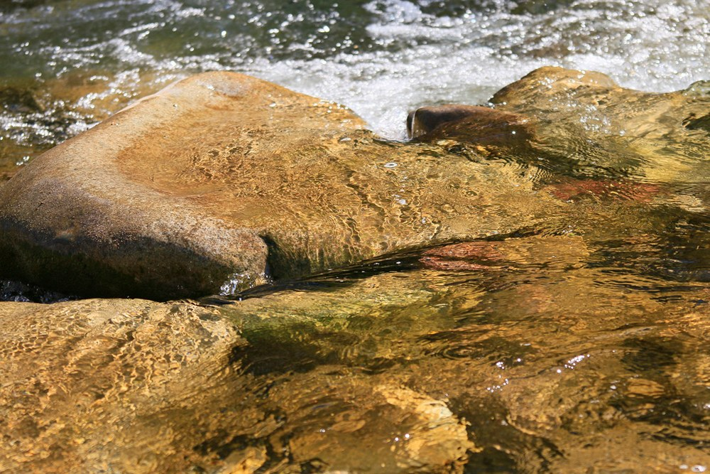 Rocks and flowing water.