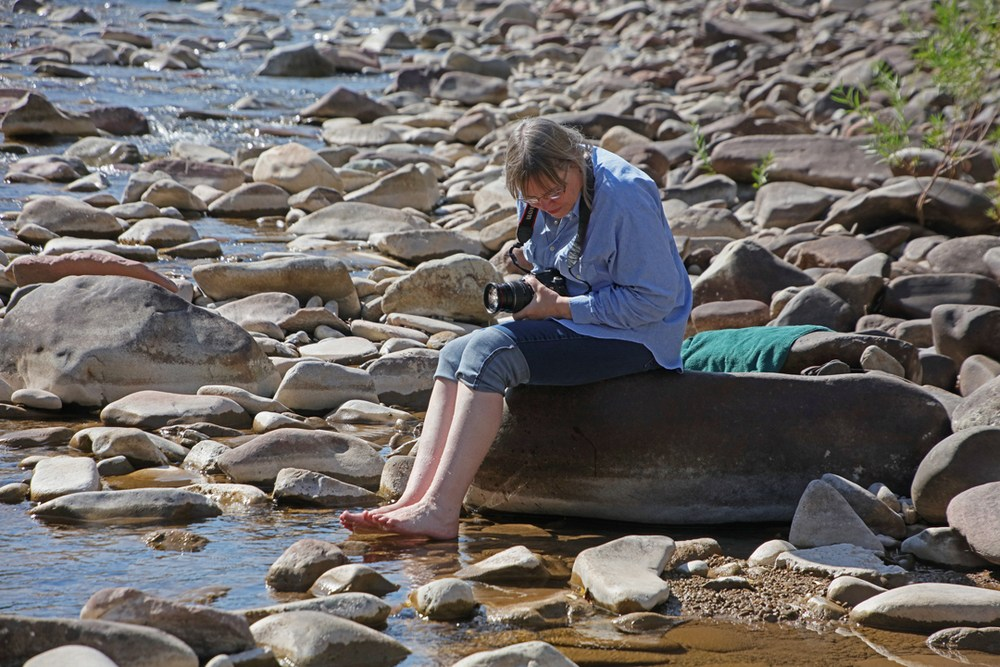Me, sitting on boulders at the river.
