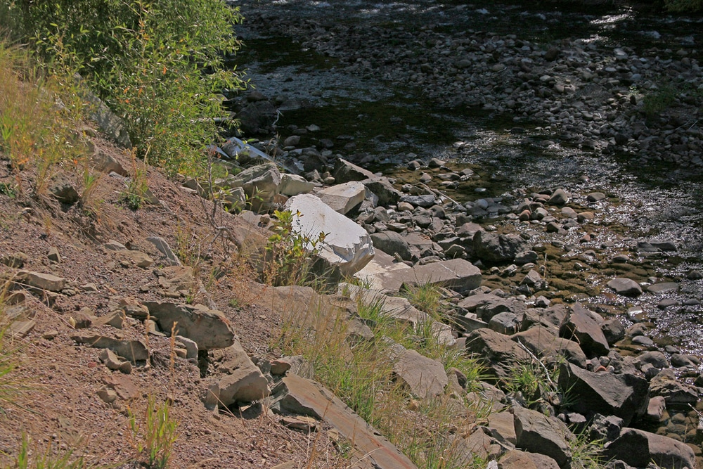 Marble chunk on river bank.