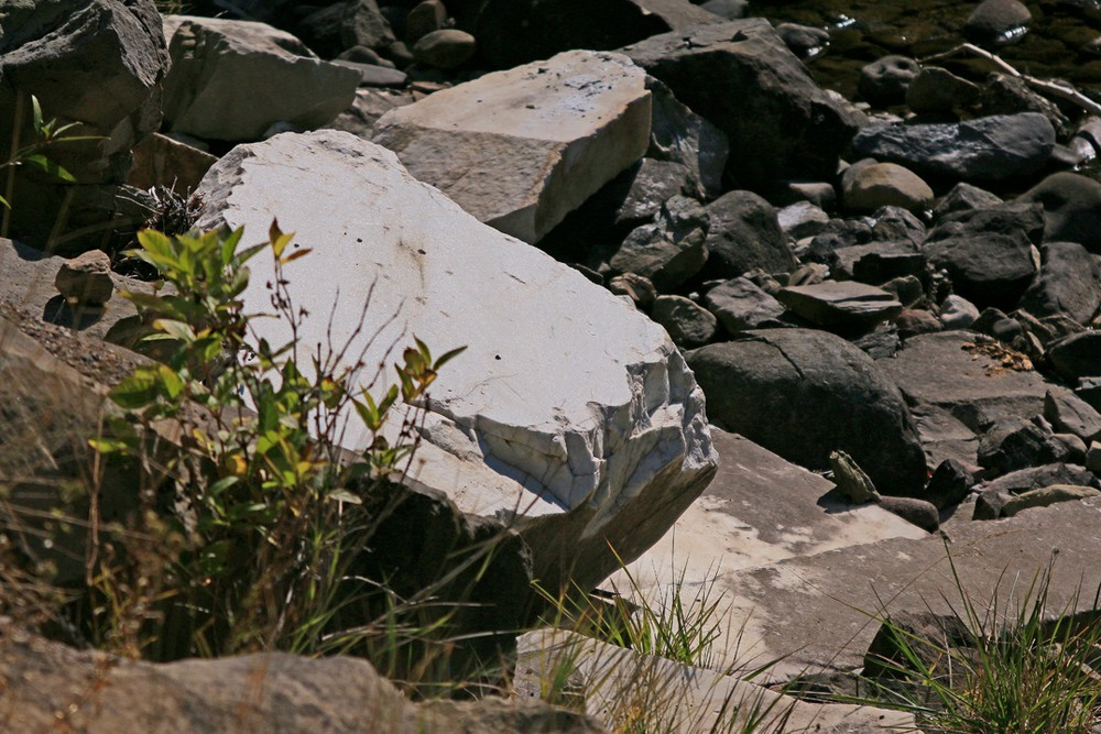 Cut marble slab on river bank, washed downstream from quarry.