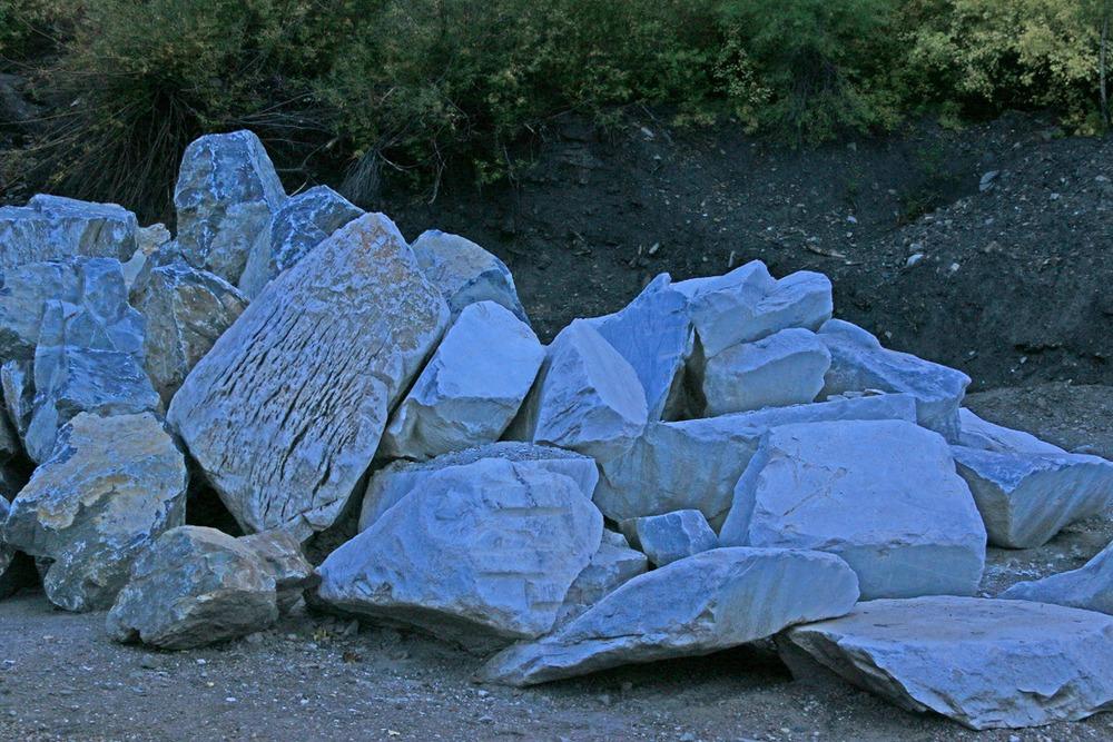 Rocks lining the road side near gate.