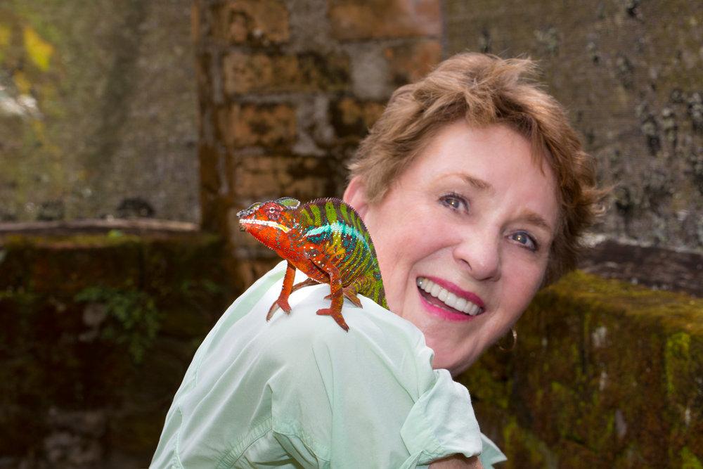 Nicki Geigert, Photographer. Image of Nicki with an animal friend on her shoulder.