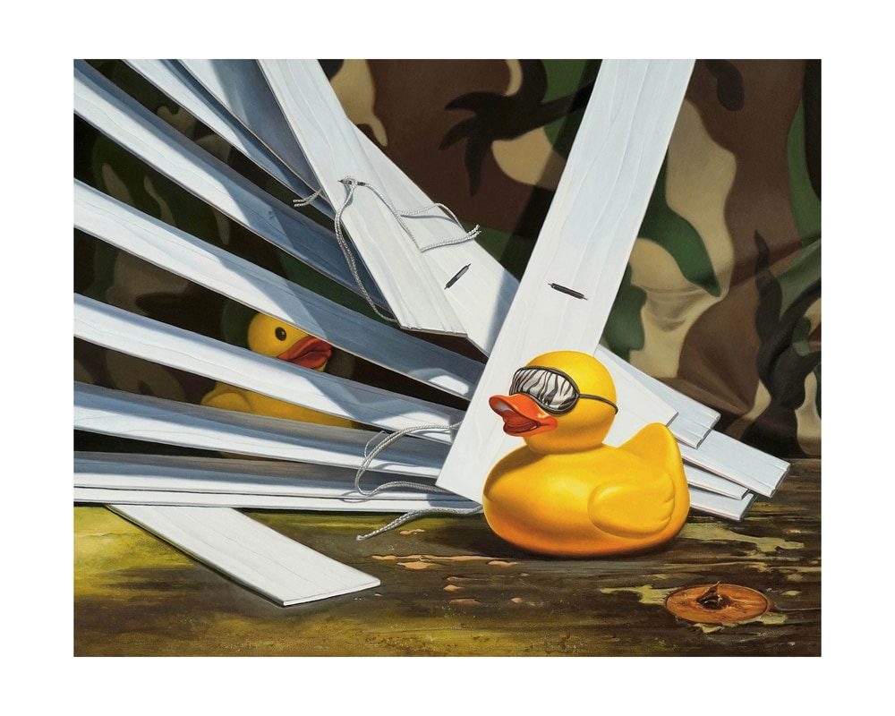 """""""Duck Blind"""" shows a play on the hunting blind with a rubber duck with eye mask and one playing hide-and-seek in window blinds."""