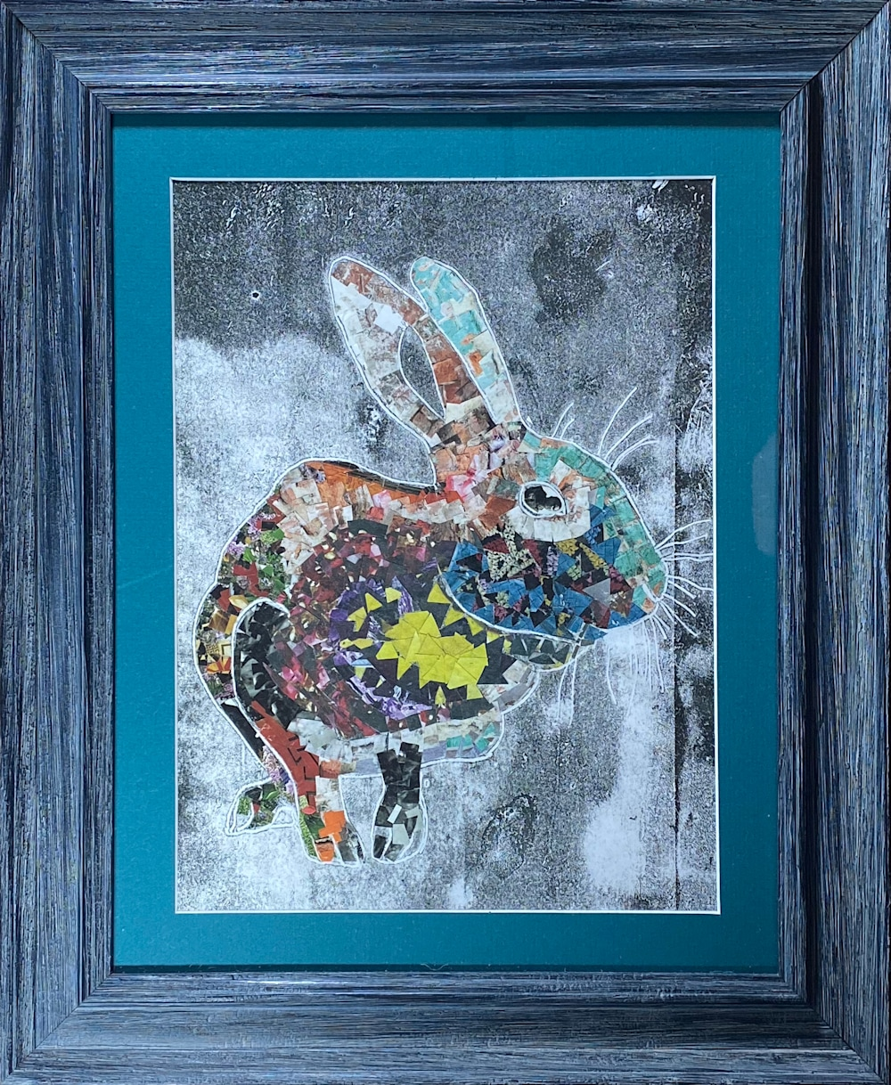 Collaged rainbow rabbit in dark teal frame with turquoise matting.