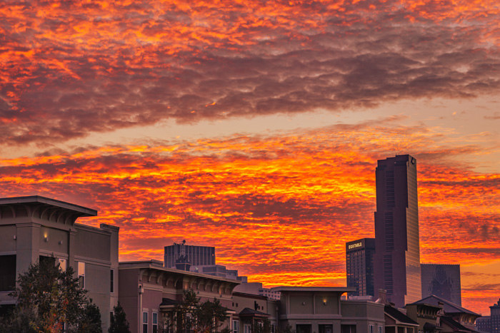 A fiery orange-cloud sunset behind the City of Atlanta