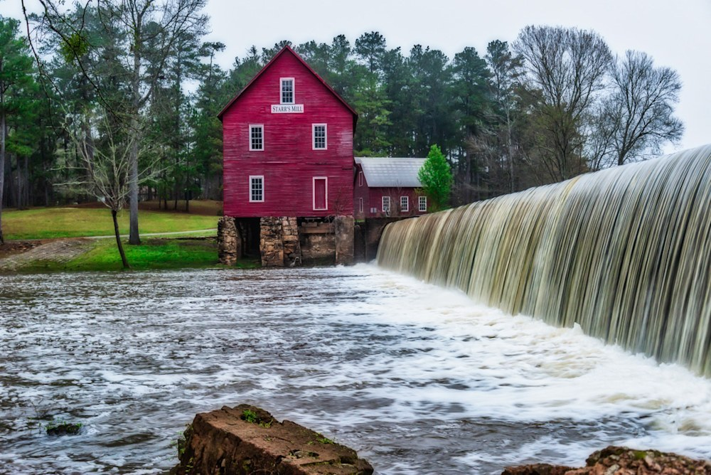 A photo of Starr's Mill and the mini-waterfall in front of it