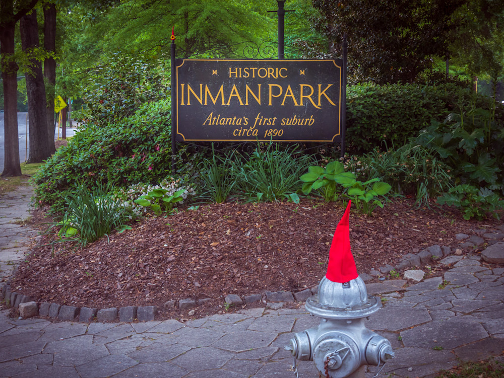 Historic Inman Park sign with a gnome-hatted fire hydrant in the foreground