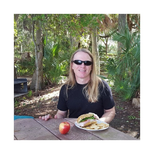 Artist Kevin Grass at a picnic in Anderson Park, Florida.