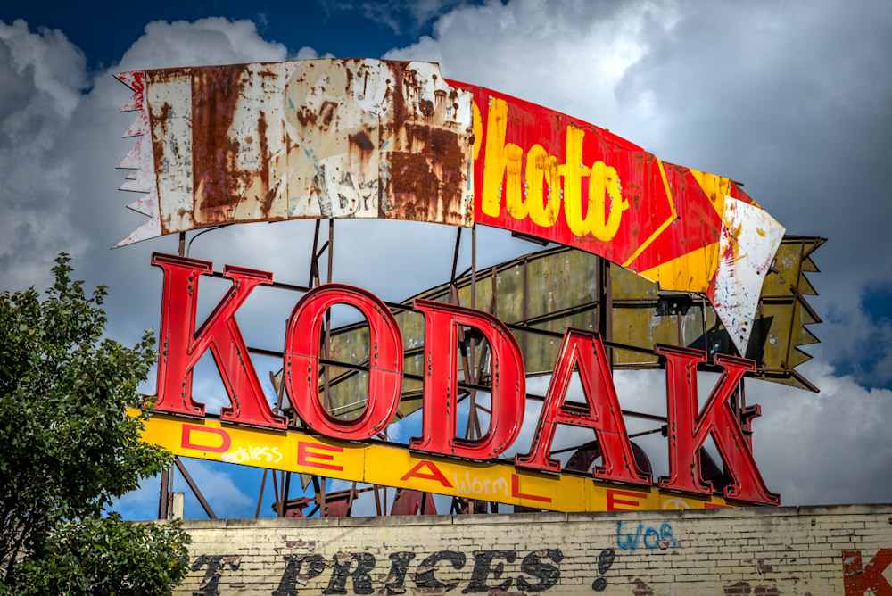 An old, tarnished, decaying Kodak sign on top of a building in Atlanta