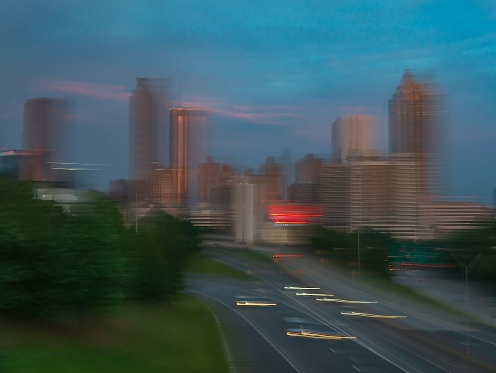 The City of Atlanta from Jackson Street Bridge at sunrise. The photo is blurred by intentional camera movement