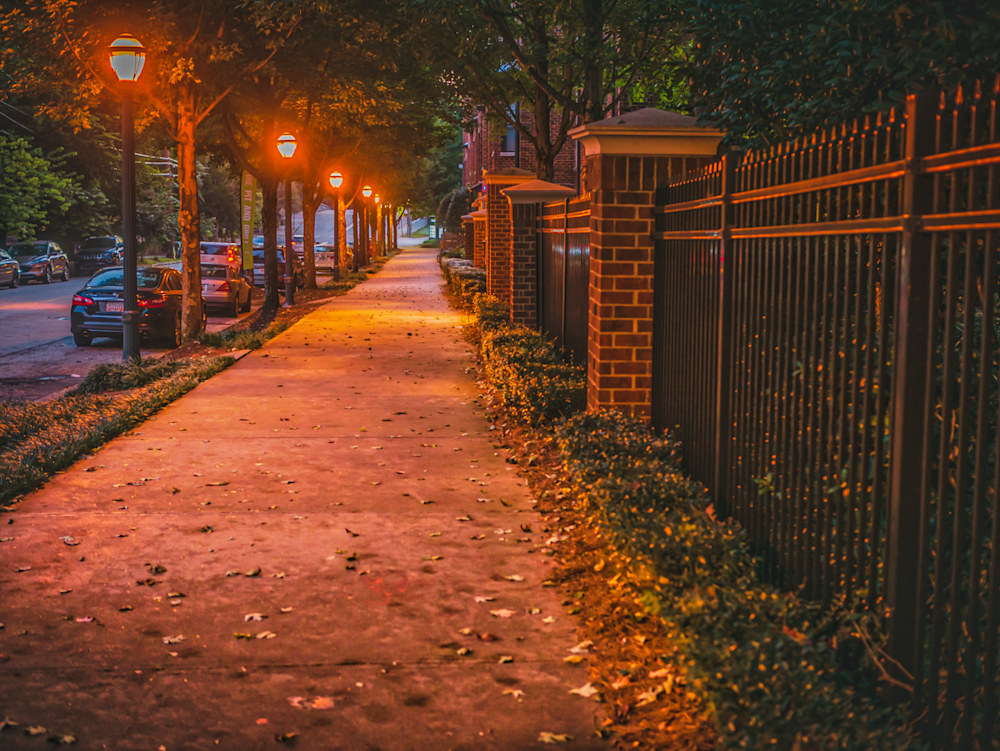 The path on Highland Avenue in the early morning with the glowing street lights still lighting the path