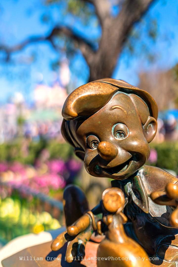 Pinocchio and Jiminy Cricket Statues