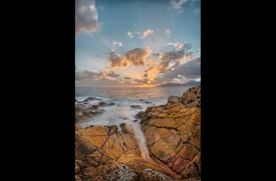 Sunset_-_tour_de_capitello_beach_-_corsica_-_france_oyv8mk