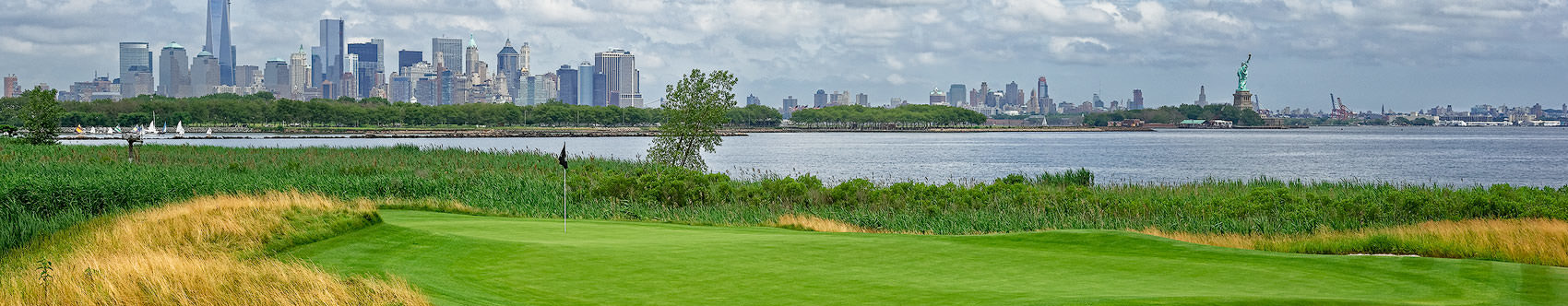 <div class='title'>           LIBERTY NATIONAL GOLF CLUB'S 14TH HOLE         </div>                 <div class='description'>           Across the 14th green, with the Manhattan skyline to the left and The Statue of Liberty to the right, in the background.         </div>