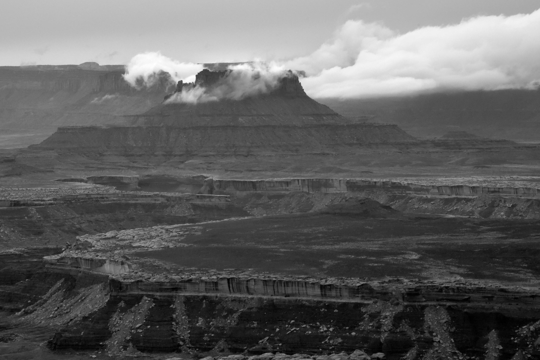 <div class='title'>           Ekker-Butte         </div>                 <div class='description'>           Clouds surrounding Ekker Butte in Canyonlands National Park         </div>
