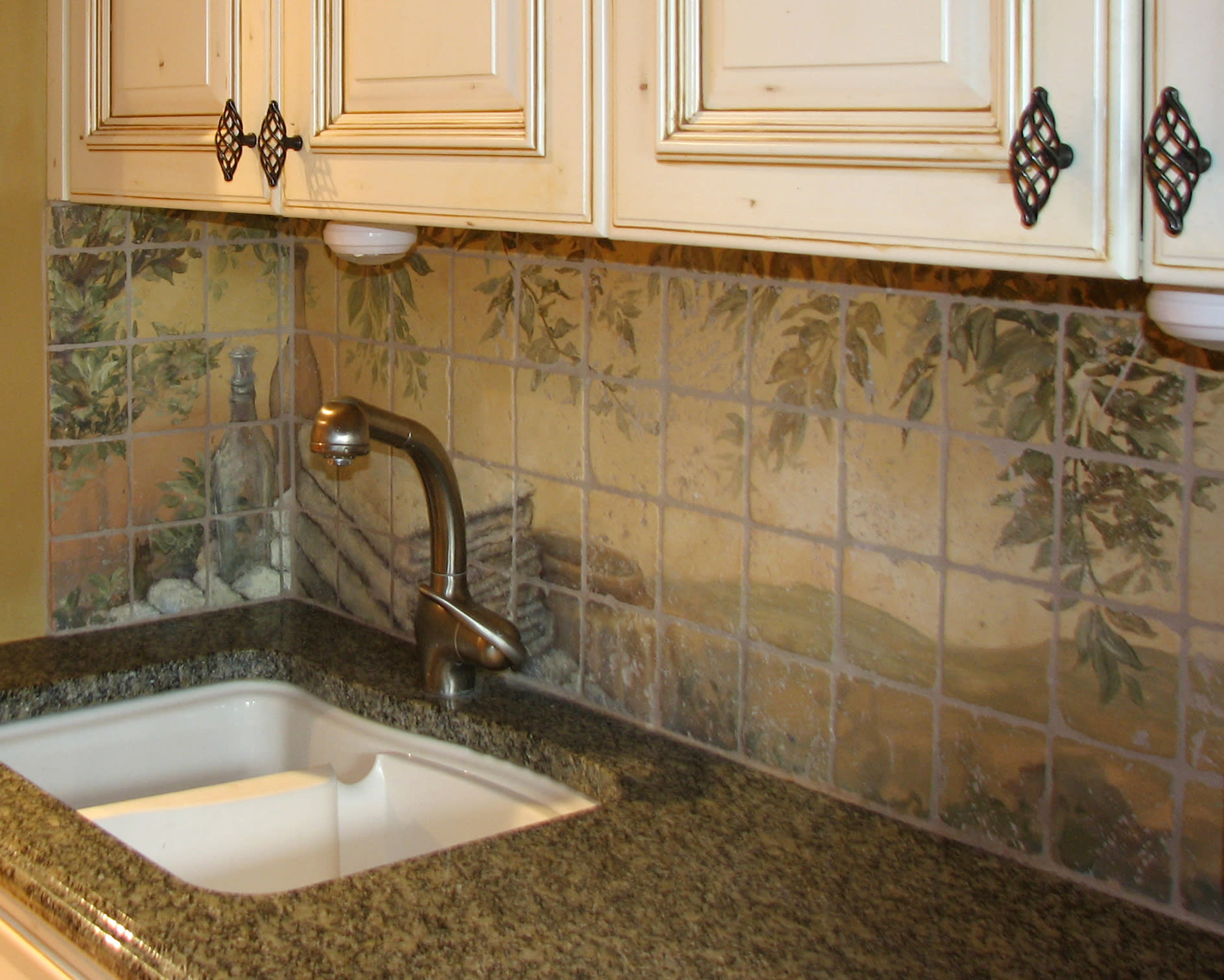 "<div class='title'>           Laundry Backsplash on tumbled marble         </div>                 <div class='description'>           ""Tuscan"" feel with olive trees... and folded towels in this laundry backsplash painted on tumbled marble tiles         </div>"