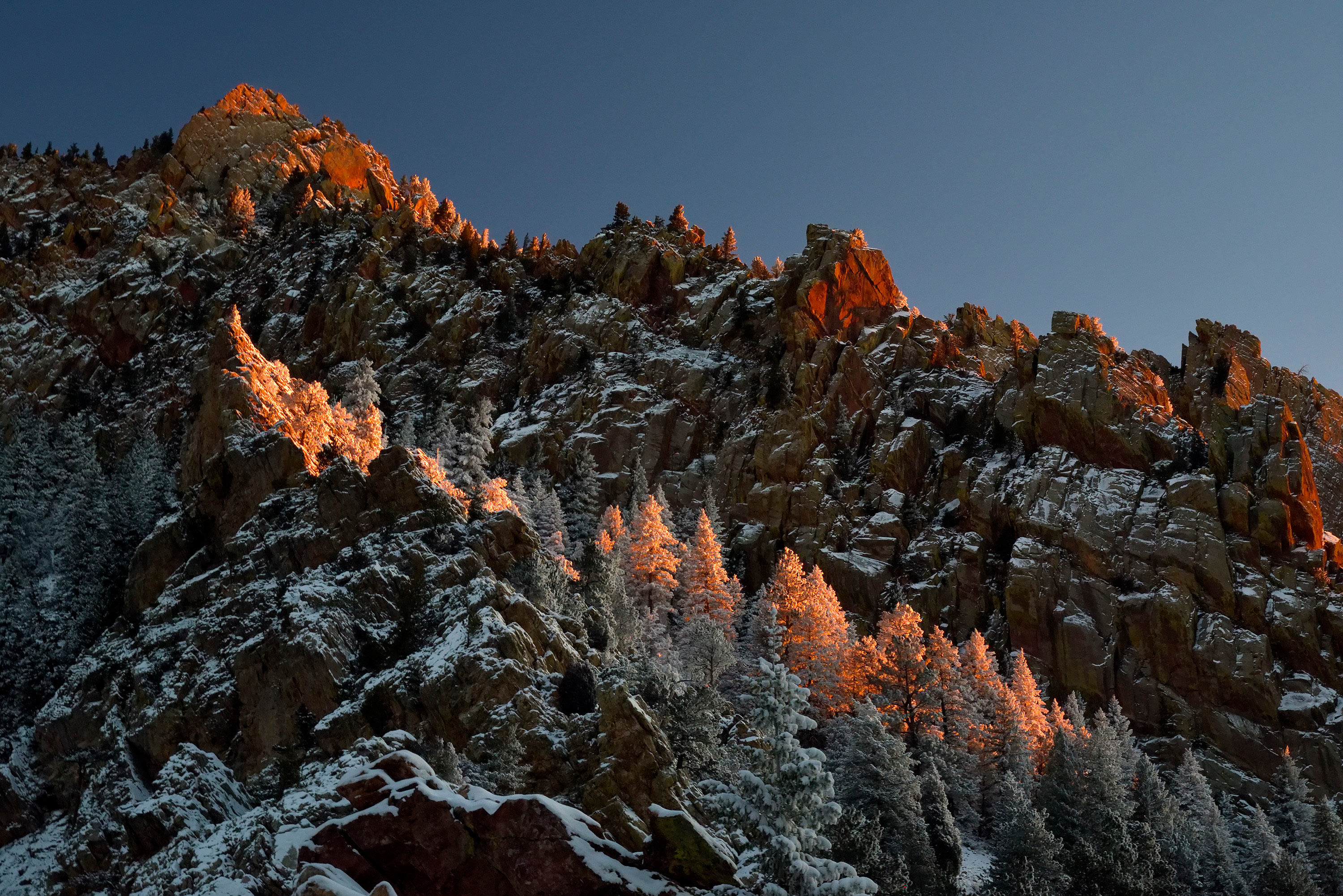 <div class='title'>           Eldorado Dawn         </div>                 <div class='description'>           The first light of the morning casts a warm glow high on the walls of Eldorado Canyon, the morning after a frest winter snow. The contrast of warm sunlight and cool winter shadows is captivating, coming together on the snow covered trees clinging to the canyon walls.         </div>