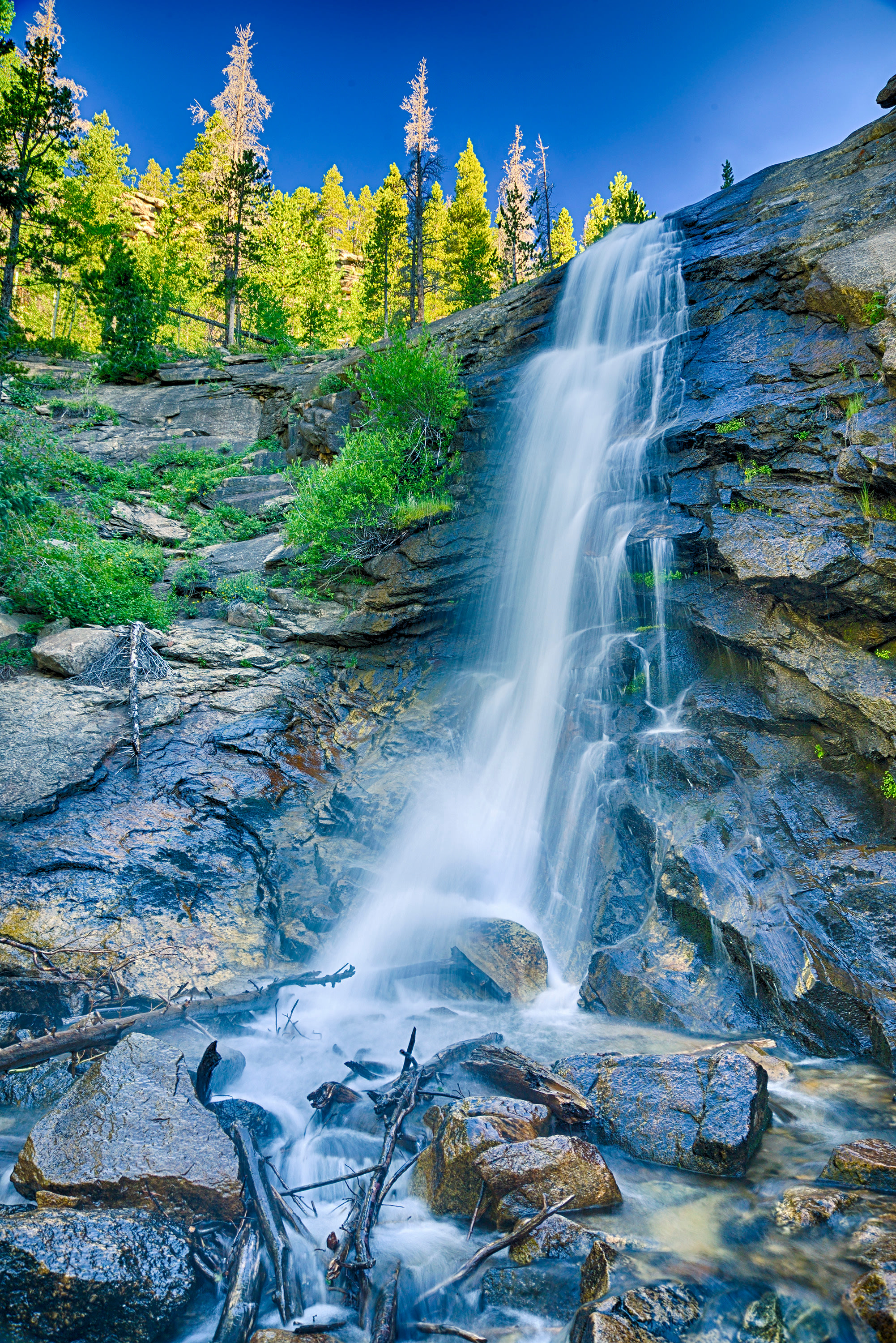 <div class='title'>           Bridal Veil Falls         </div>                 <div class='description'>           The waters of Cow Creek spill over Bridal Veil Falls onto the rocks below in this image in Rocky Mountain National Park.         </div>