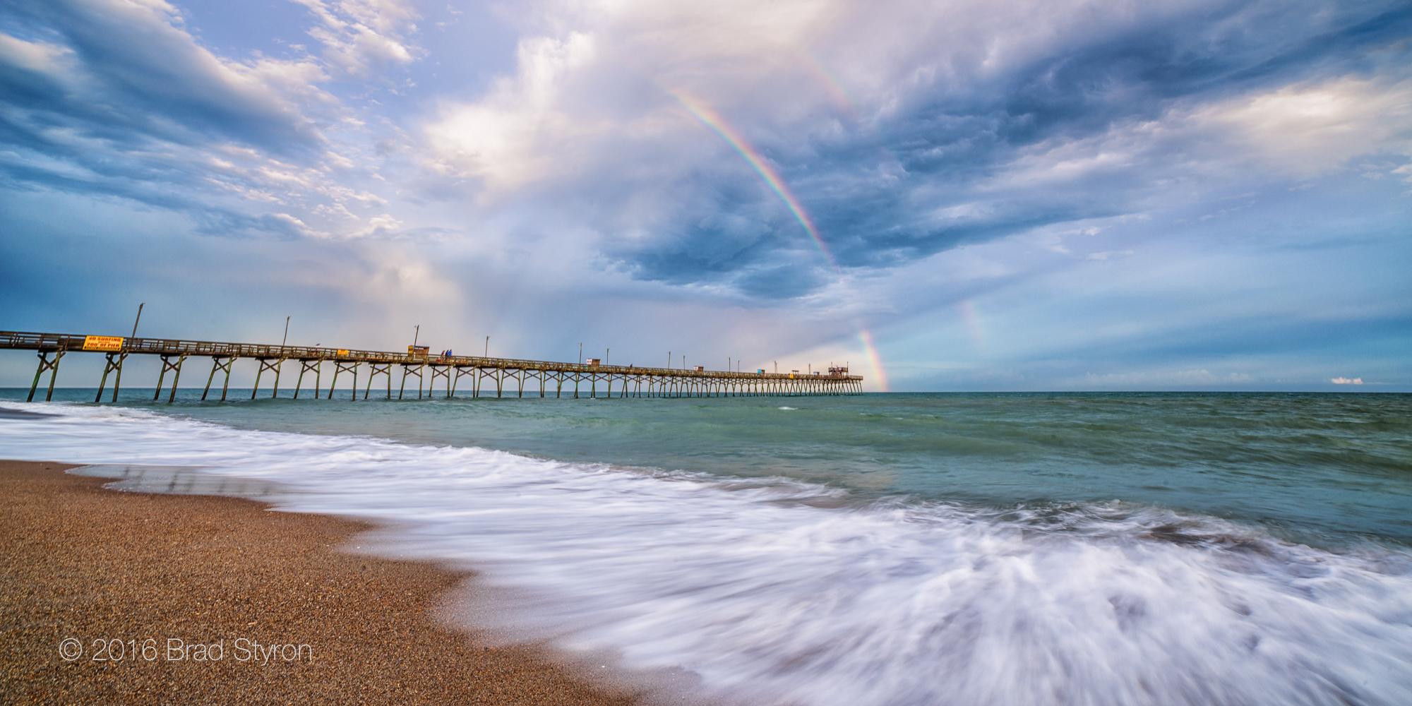 <div class='title'>           rainbow-over-bogue-pier-xurusq         </div>                 <div class='description'>           Rainbow over Bogue Inlet Pier         </div>
