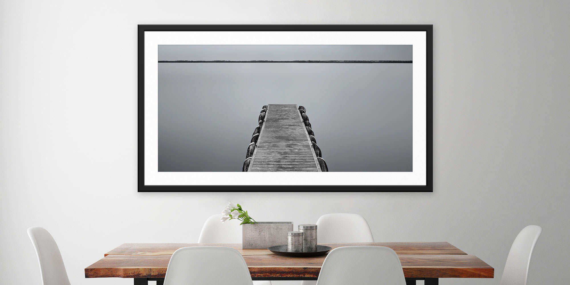 <div class='title'>           Silver Safety Harbor - Safety Harbor, FL by Andrew Vernon         </div>                 <div class='description'>           A framed and matted print of Silver Safety Harbor by Andrew Vernon hangs in a modern dining room         </div>