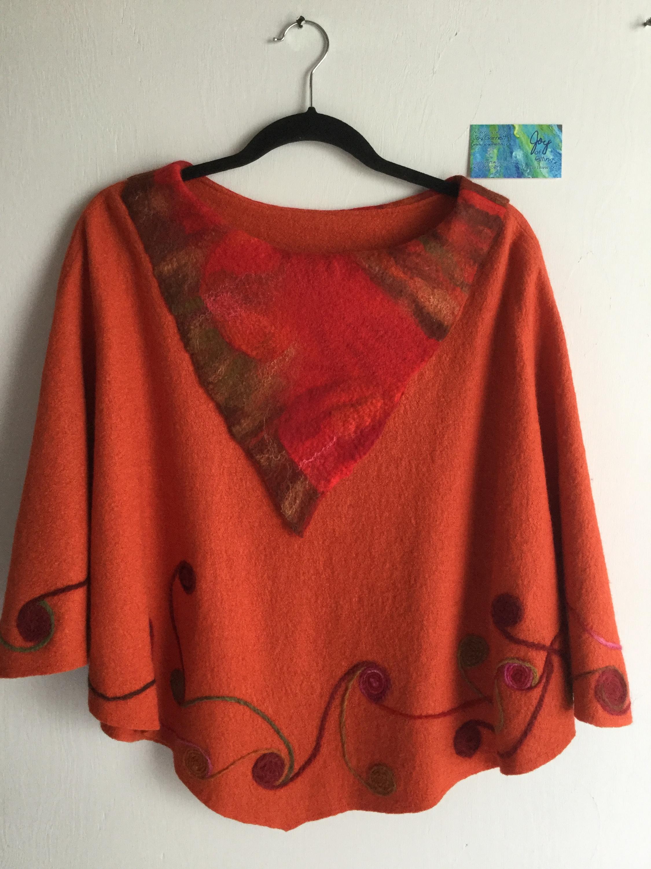 Orange felt art shawl back m7gk5l