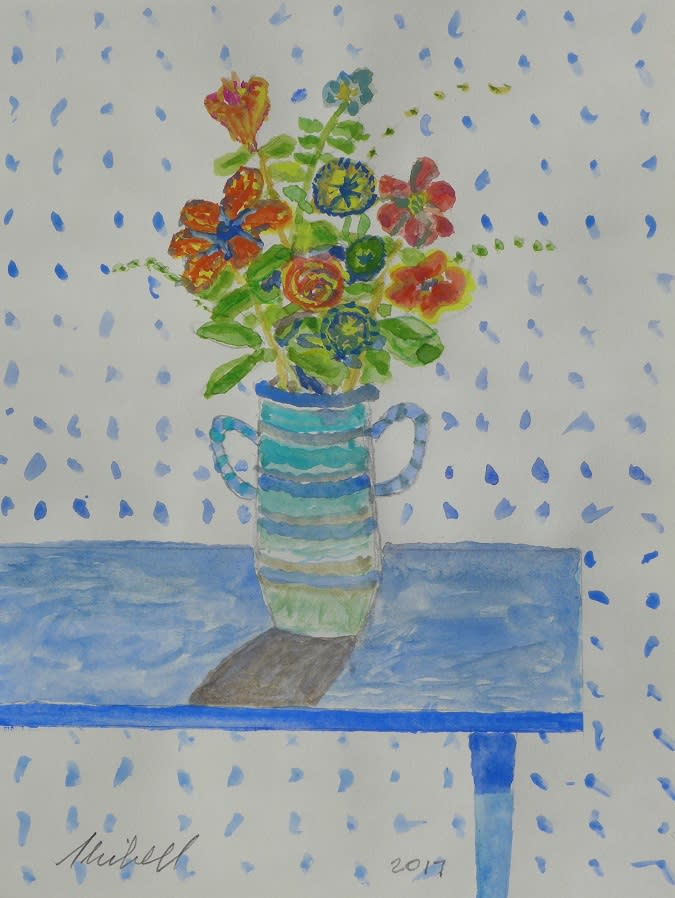 Flowers in blue vase on blue table skibell lvw3jw