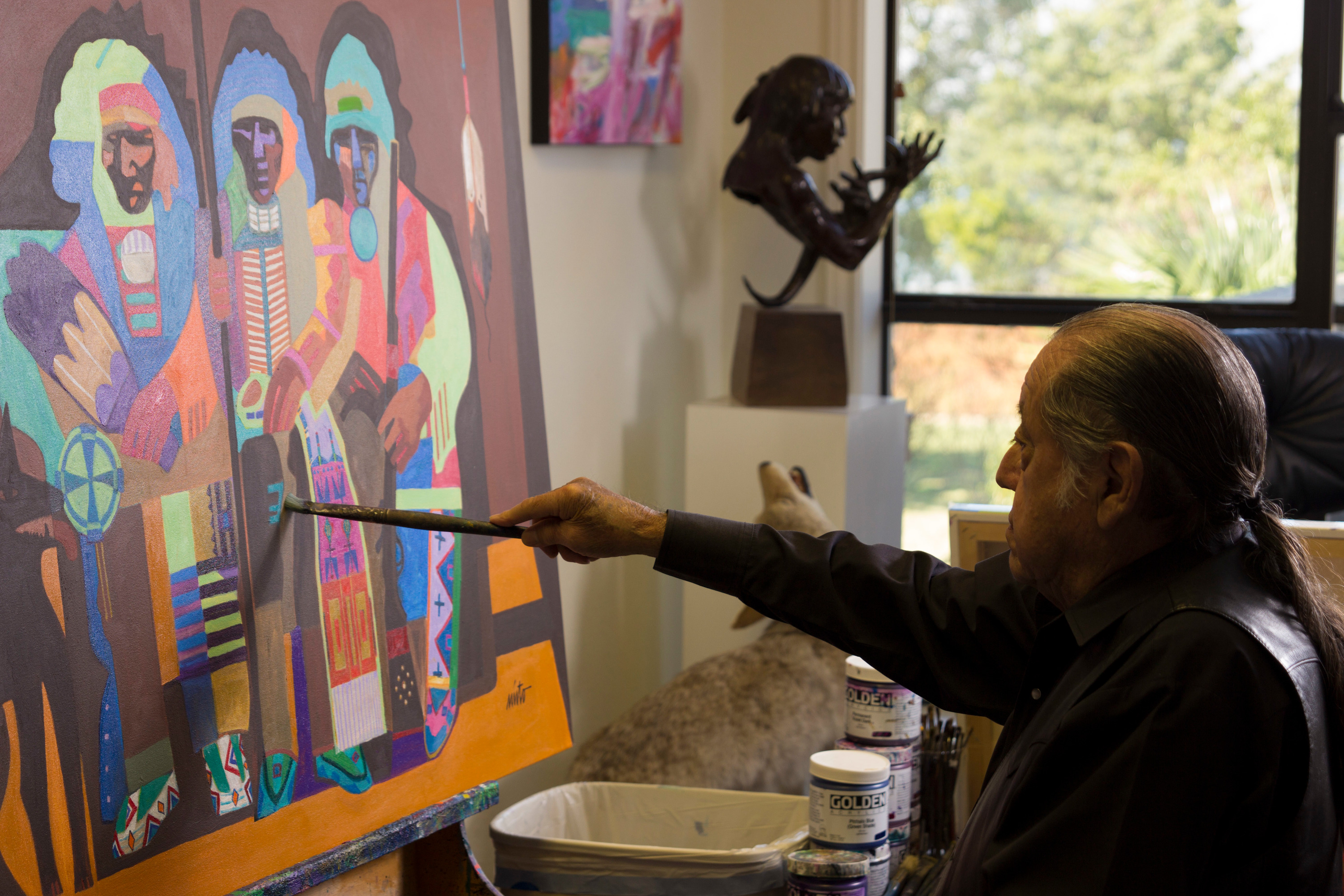 <div class='title'>           John  Nieto painting, in the studio, acrylic painting, native american painting         </div>                 <div class='description'>           John Nieto painting in his studio         </div>
